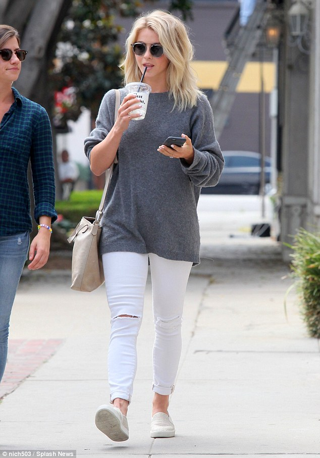 Living the Hollywood dream: Quenching her thirst in the sunny Californian rays, the Utah native sipped on a juice drink, while carrying her phone in her other perfectly manicured hands- which showed off her lavish engagement ring