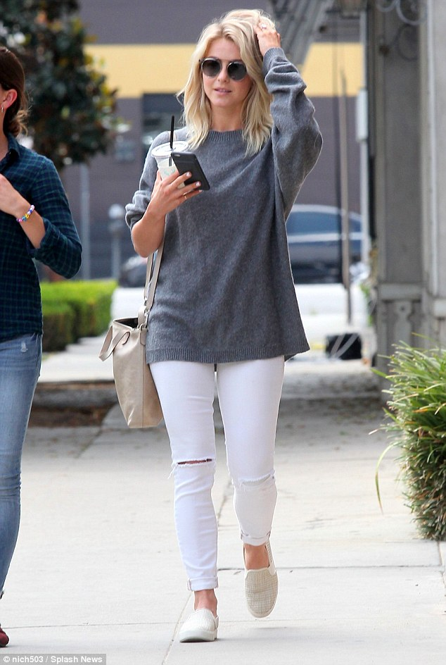 Staples: She opted for maximum comfort in a pair of cream plimsolls as she carried a matching slouchy handbag on her right shoulder