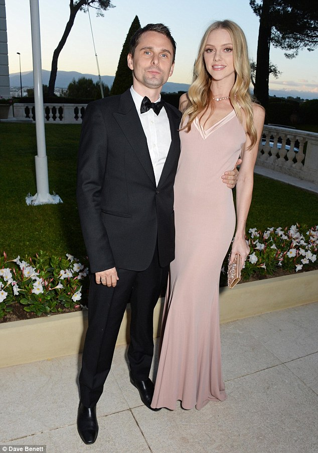 Handsome pair:The 26-year-old blonde beauty slipped into a stunning dusky pink gown while her Muse frontman beau, 37, looked dashing in a tuxedo