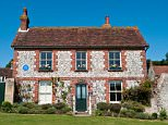 DAA9MK Pendrills Cottage, the retirement home of fictional detective and beekeeper Sherlock Holmes, in East Dean, East Sussex, England