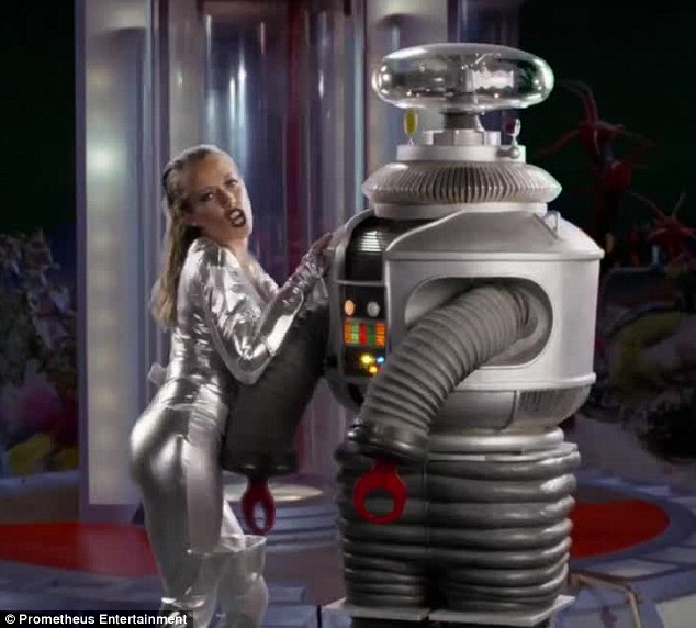 Lost in translation? Kendra Wilkinson proudly debuted her provocative music video Lost in Space on Friday