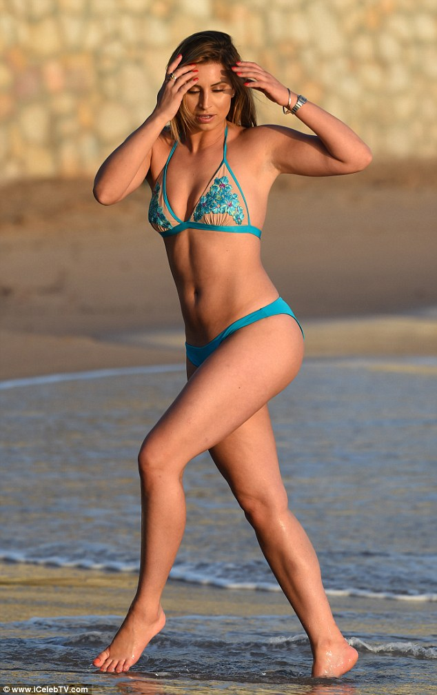 Showing out: Proudly displaying her fit figure, the I'm A Celebrity star oozed sex appeal in the turquoise two-piece which left little to the imagination