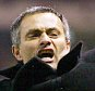 Porto manager Jose Mourinho jumps in the air as he celebrates beating Manchester United in their Champions League first knockout round, second leg soccer match at Old Trafford, Manchester, March 9, 2004. The match ended 1-1 on the night with FC Porto knocking Manchester United out 3-2 on aggregate. REUTERS/Ian Hodgson  IH/MD/JV
