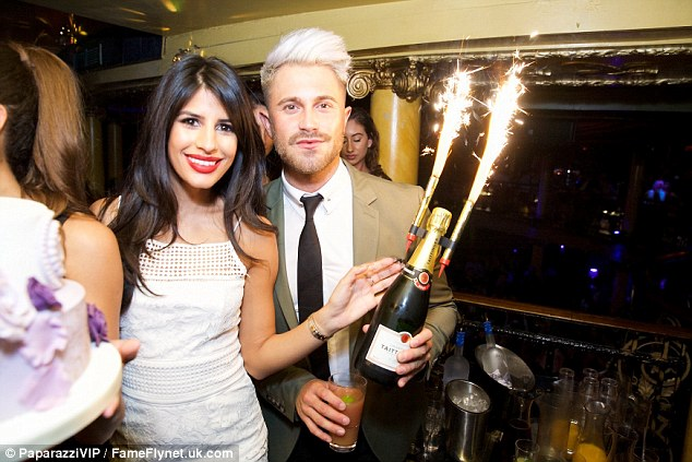 Lighting her fire: Jasmin Walia looked pretty in white as she celebrated her birthday alongside boyfriend Ross Worswick at London's Cafe De Paris on Saturday night