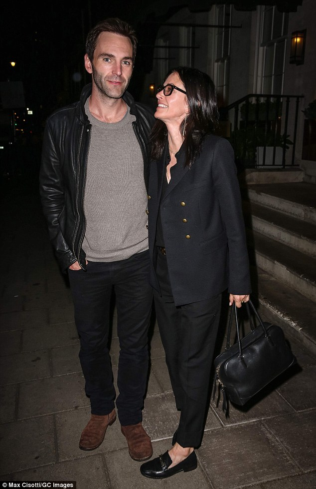 The look of love: Courteney Cox proved just how besotted she was with her fiance Johnny McDaid as they left Restaurant 34 in Mayfair, London on Sunday after a romantic date night