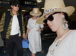 MIAMI, FL - MAY 22:  (EXCLUSIVE COVERAGE)Orlando Bloom and  Katy Perry are seen at Miami International Airport on May 22, 2016 in Miami, Florida.  (Photo by Gustavo Caballero/GC Images)