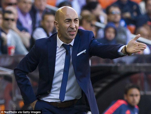 Neville is now working under his third boss after Pako Ayestaran replaced his brother Gary in April