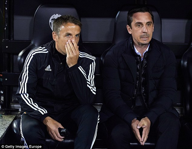 Gary Neville joined his brother Phil (left) at the club but his reign ended after he was dismissed from his role