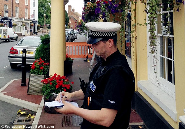 Investigation A police officer stands outside the Grade II-listed building following the death of Mr James