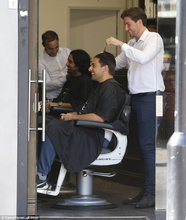 TLC: Arg was seen getting a trim, laughing away in the stylist's chair