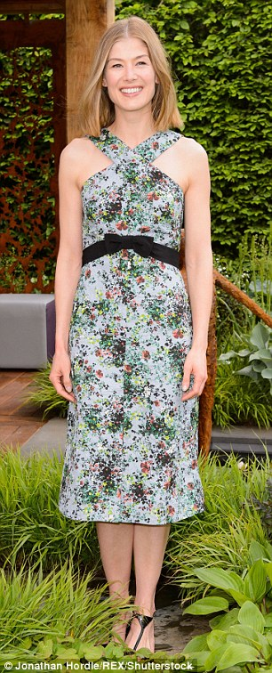 Flower power: Rosemund Pike looked sensational in a midi-length floral number