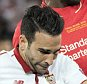 Sevilla's Adil Rami, left, challenges for the ball with Liverpool's Divock Origi, right, during the soccer Europa League final between England's Liverpool FC and Spain's Sevilla Futbol Club at the St. Jakob-Park stadium in Basel, Switzerland, on Wednesday, May 18, 2016. (Georgios Kefalas/Keystone via AP)