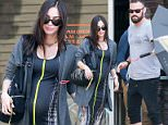 Exclusive... 52066392 Pregnant Megan Fox was spotted grabbing lunch at Cafe Grattitude in bright and sunny Los Angeles, California on May 20, 2016 with her husband, Brian Austin Green. Megan and Brian are currently trying to work things out with their struggling relationship, and Brian was seen trying to prevent Megan from being photographed by unsuccessfully covering her with an umbrella. ***NO WEB USE W/O PRIOR AGREEMENT - CALL FOR PRICING*** FameFlynet, Inc - Beverly Hills, CA, USA - +1 (310) 505-9876