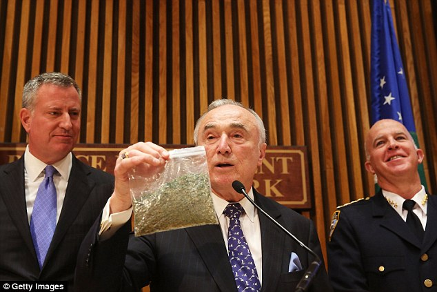 William Bratton (pictured in November) holds up a bag of oregano to demonstrate what a bag of weed looks like. Bratton said that marijuana trafficking is behind the 'vast majority' of drug-related violence in the city