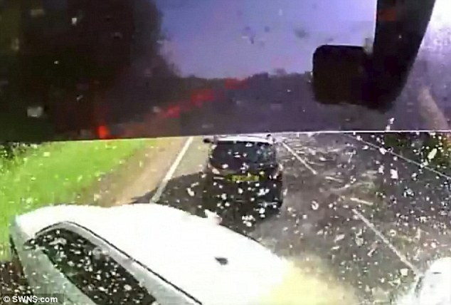 Veering aside: Shocking dash-cam footage shows the huge articulated truck speeding down a country road before colliding with a white Renault Kangoo