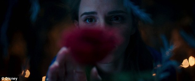 Irresistible: Belle (Emma Watson) reaches out to touch the red rose