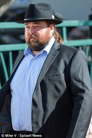Chumlee, is seen leaving at the Regional Justice Center in Downtown Las Vegas. He's agreed to three years probation to avoid jail time