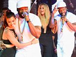 LAS VEGAS, NV - MAY 22:  (L-R) Rapper Lil Fate, Khloe Kardashian and rapper 50 Cent appear onstage during the official Billboard Music Awards after party at Drai's Beach Club - Nightclub at The Cromwell Las Vegas on May 22, 2016 in Las Vegas, Nevada.  (Photo by Bryan Steffy/BBMA2016/Getty Images for dcp)