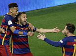 epa05324263 FC Barcelona's Jordi Alba (C), celebrates with teammates Lionel Messi (R), and Neymar Jr after scoring during the Spanish King's Cup final between FC Barcelona and Sevilla FC at Vicente Calderon stadium in Madrid, Spain, 22 May 2016.  EPA/CHEMA MOYA