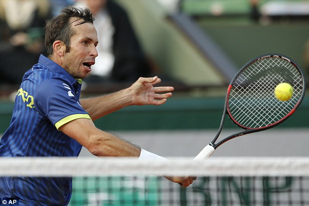 The 37-year-old, the oldest man in the French Open draw, plays a backhand shot