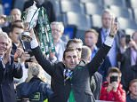 Hibernian manager Alan Stubbs lifts the cup after winning the William Hill Scottish Cup Final, at Hampden Park, Glasgow. PRESS ASSOCIATION Photo. Picture date: Saturday May 21, 2016. See PA story SOCCER Scottish Final. Photo credit should read: Jeff Holmes/PA Wire. EDITORIAL USE ONLY
