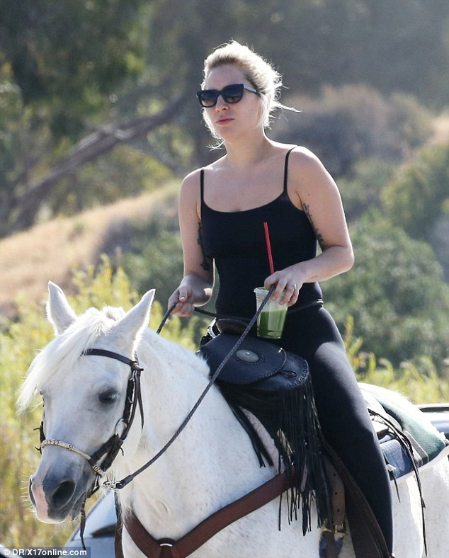 Four legs are better than four wheels: The 30-year-old blonde hit maker took her white horse to the Malibu Country Mart to pick up a green smoothie