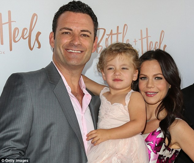 'Thank you to the people who believed in this': The brunette beauty shared a lovely snap with her family at the launch