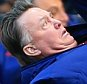 28th February 2016 - Barclays Premier League - Manchester United v Arsenal - Man Utd manager Louis van Gaal lies on the ground in front of fourth official Mike Dean - Photo: Simon Stacpoole / Offside.