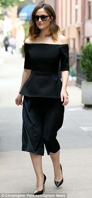 Slender: The Hollywood A-lister opted for a pair of loose trousers which finished just below her knee