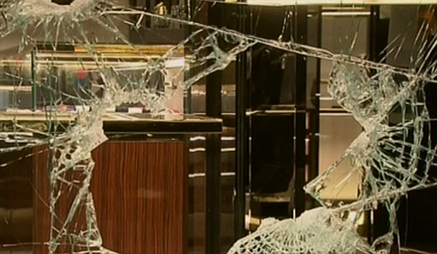 The alleged criminals stole thousands of dollars worth of handbags after smashing the window at the front of the high-fashion store