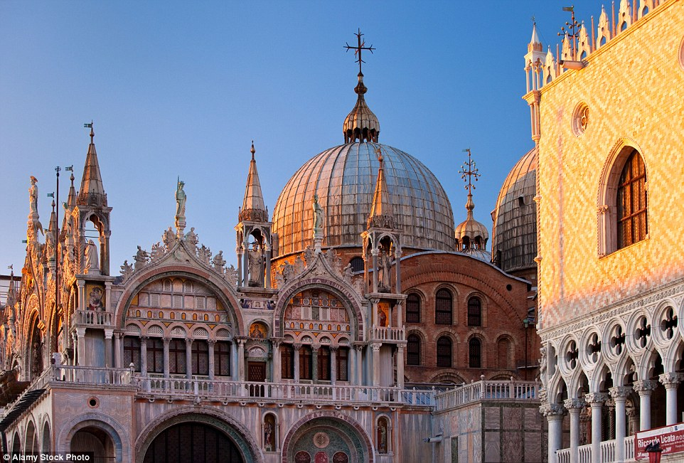 Although there are times when tourists outnumber locals by two to one, visitors are never more than a bridge or an alley away from a secluded square or Gothic palazzi in the Italian city. Pictured is the Basilica, San Marco