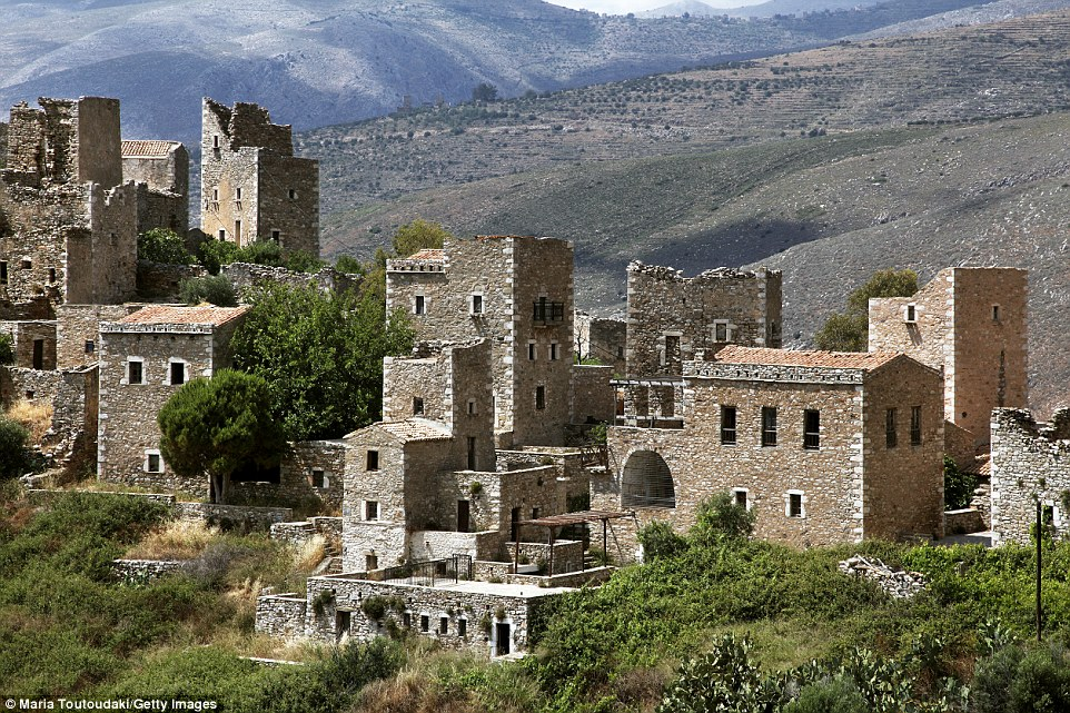 Forget Athens or the Greek islands, journey to the prehistoric peninsula of Peloponnese to discover spellbinding scenery, rugged mountains and a land steeped in myth. Pictured is a traditional village with towers built with stone