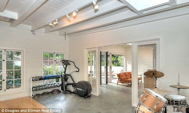 Work out: The property boasts a full gym and music room