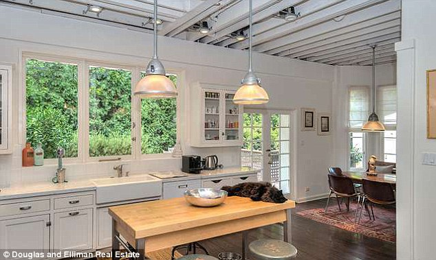 Sunny: It also features a rustic Provencal-style kitchen