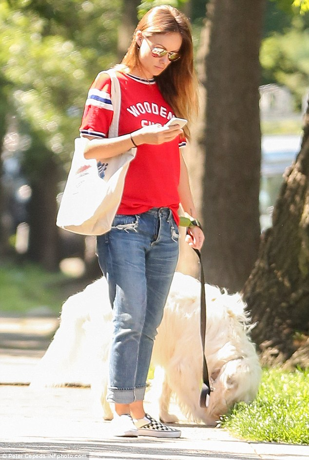 Focused: The 32-year-old pregnant star donned a loose-fitting red T-shirt with cropped jeans and slip-on shoes for her daytime outing with her dog Paco