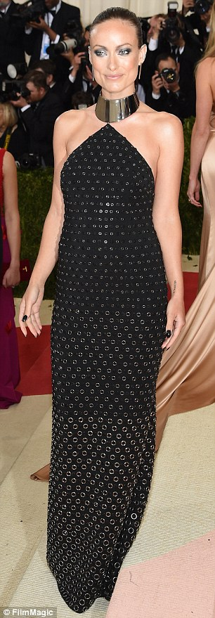 Dresssed to the nines: The starlet looked incredible in a black and gold Michael Kors dress, pairing it with black polish and a slicked back ponytail
