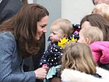The Duchess of Cambridge talks to wellwishers as she arrives to open a new charity shop for the East Anglia's Children's Hospices in Holt, Norfolk.