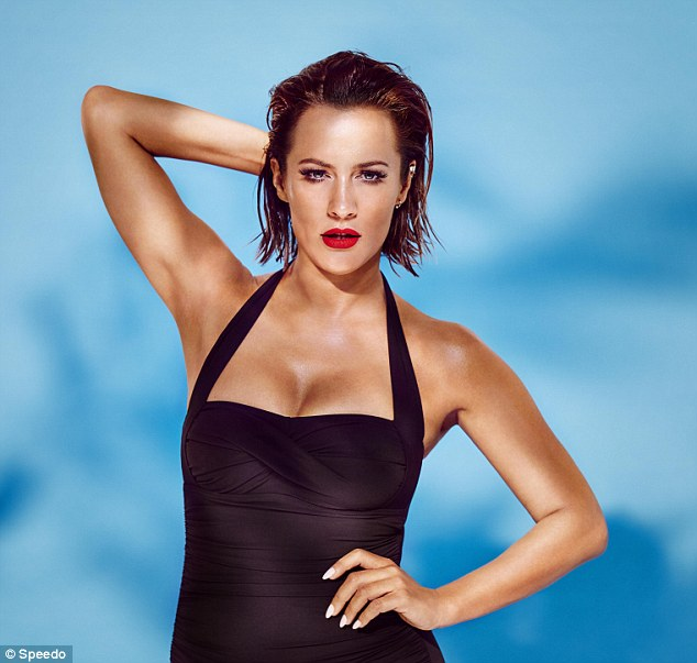 She's a natural: The 36-year-old puts on a busty display in a black halter-neck swimsuit as she oozes sex appeal with striking rep lipstick and wet locks