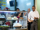 President Barack Obama greets women at the door as he walks from the Bún ch¿ H¿¿ng Liên restaurant after having dinner with American Chef Anthony Bourdain in Hanoi, Vietnam, Monday, May 23, 2016. (AP Photo/Carolyn Kaster)