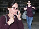 Los Angeles, CA - Courteney Cox arrives at LAX on Monday wearing jeans and a sweater paired with loafers. Courteney Cox loves donning this simple minimalistic look. \nAKM-GSI         May 23, 2016\nTo License These Photos, Please Contact :\nSteve Ginsburg\n(310) 505-8447\n(323) 423-9397\nsteve@akmgsi.com\nsales@akmgsi.com\nor\nMaria Buda\n(917) 242-1505\nmbuda@akmgsi.com\nginsburgspalyinc@gmail.com