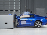 This March 24, 2016, photo provided by the Insurance Institute for Highway Safety shows a 2016 Chevrolet Camaro during a crash test at the IIHS Vehicle Research Center in Ruckersville, Va. The Ford Mustang, Chevrolet Camaro and Dodge Challenger didn¿t get the highest ratings in new tests by the IIHS. (Insurance Institute for Highway Safety via AP) MANDATORY CREDIT