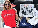 """Former Spice Girl, Mel C, was spotted selling off her Spice Girl memorabilia at a """"Star Boot Sale"""" in East London. The 42 year old singer looked in great shape as she did her best to shift some of her t shirts, signed Spice Girl pictures and even a bright red t shirt with 'Sporty Spice' written across it! She was joined by Scottish singer KT Tunstall who brought a huge amount of her possessions and looked to be enjoying selling some of her things including a silver guitar case, a wooden sun umbrella and even a soft toy called """"Bob the Bat"""". Badly Drawn Boy had his own sales tent pitched up and after a hug from Mel C, started selling his items and even signed a mug to a lucky fan. The aim of the boot sale is to raise �100,000 for mobile health clinics to help Syrian refugees."""