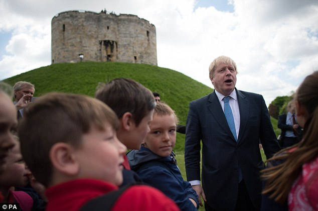Today Boris Johnson (pictured meeting school children in York) dismissed an 83-page Treasury report warning that a Brexit vote is the 'self-destruct option' that could cost 800,000 job, a recession on the scale of the credit crunch and a £220 a year rise in food bills