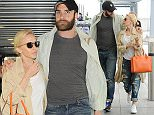 ***EXCLUSIVE ALL-ROUNDER £200 PER PICTURE PRINT / £300 SET ONLINE *** Kylie Minogue and fiance Joshua pictured happily arriving arm in arm at heathrow airport this afternoon.