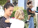 EXCLUSIVE - Alessandra Ambrosio nails it in a black and white striped midriff top, bell bottom jeans and wedge sandals as she spends quality time with adorable son Noah in Santa Monica, CA. Tuesday, May 24, 2016. Globo/X17online.com