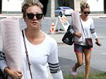 Thousand Oaks, CA - Kaley Cuoco looks ready for yoga class with her cute pink yoga mat and matching slides. Kaley  shows off her toned and tan legs in athletic shorts as she heads inside.\n  \nAKM-GSI       May 23, 2016\nTo License These Photos, Please Contact :\nSteve Ginsburg\n(310) 505-8447\n(323) 423-9397\nsteve@akmgsi.com\nsales@akmgsi.com\nor\nMaria Buda\n(917) 242-1505\nmbuda@akmgsi.com\nginsburgspalyinc@gmail.com