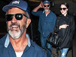 EXCLUSIVE: Mel Gibson and his girlfriend Rosalind Ross seen at LAX airport in Los Angeles, California on May 23, 2016.\n\nPictured: Mel Gibson and Rosalind Ross\nRef: SPL1285408  230516   EXCLUSIVE\nPicture by: Diabolik / Splash News\n\nSplash News and Pictures\nLos Angeles: 310-821-2666\nNew York: 212-619-2666\nLondon: 870-934-2666\nphotodesk@splashnews.com\n