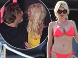 EXCLUSIVE: Chloe Sims is seen arriving at boyfriend Robert Tchenguiz's yacht in Cannes. Chloe was then seen enjoying herself stripping down from her little black dress into a bikini to lap up the South of France sunshine.