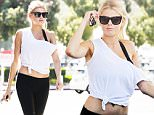 EXCLUSIVE TO INF.\nMay 22, 2016: Charlotte McKinney shows off her sex appeal in an off the shoulder crop top and tight black leggings while pumping gas in Malibu, CA.\nMandatory Credit: Borisio/SAA/INFphoto.com Ref: infusla-277/302