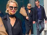 EXCLUSIVE: Sam Worthington and Lara Bingle were spotted taking a loving stroll in NYC Monday May 23 in the afternoon. The couple held hands as they strolled through SoHo , enjoying some alone time without their son Rocket . Sam even bought a bouquet of White Roses for his wife as they enjoyed the perfect weather . Lara looked pretty in a black dress, but her curves were showing as she teased a possible camp bump. She covered her stomach with the bouquet of flowers as well.\n\nPictured: Sam Worthington, Lara Bingle\nRef: SPL1289332  240516   EXCLUSIVE\nPicture by: 247PAPS.TV / Splash News\n\nSplash News and Pictures\nLos Angeles: 310-821-2666\nNew York: 212-619-2666\nLondon: 870-934-2666\nphotodesk@splashnews.com\n